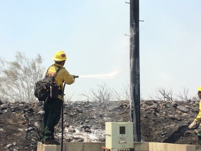 Firefighters battle flames at Banyan Street near Los Osos High School as the Etiwanda Fire burns in Rancho Cucamonga on Wednesday, April 30, 2014.