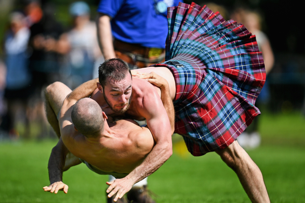 Wrestlers compete at the Inveraray Highland Games in Scotland on July 18, 2017.