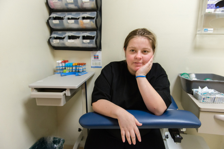 Serenity Thomason, 18, waits for a blood test for congenital syphilis during her prenatal visit at Clinica Sierra Vista.
