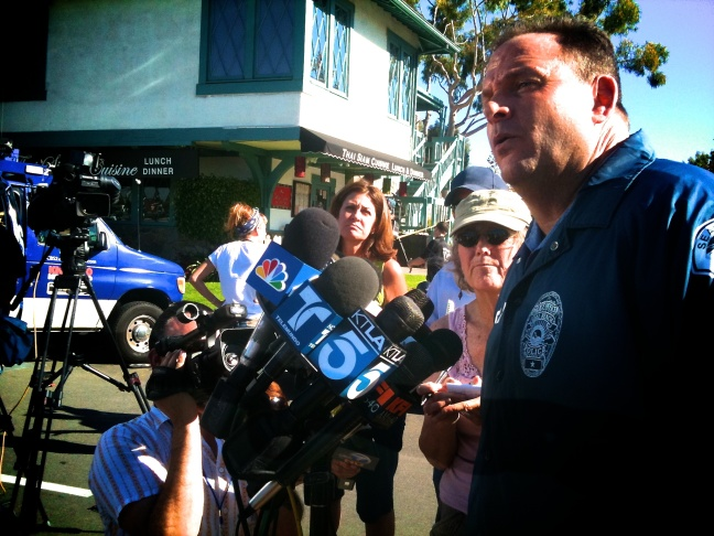 Seal Beach Police Department Sgt Steve Bowles briefs reporters about the shooting of nine people in a beauty salon in Seal Beach