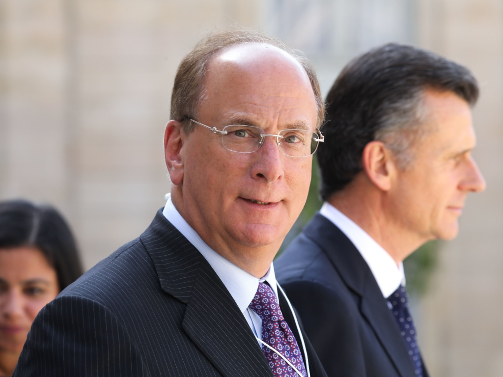 BlackRock Chairman and CEO Larry Fink, seen here in Paris in July, wrote in his annual letter to CEOs that climate change will soon cause