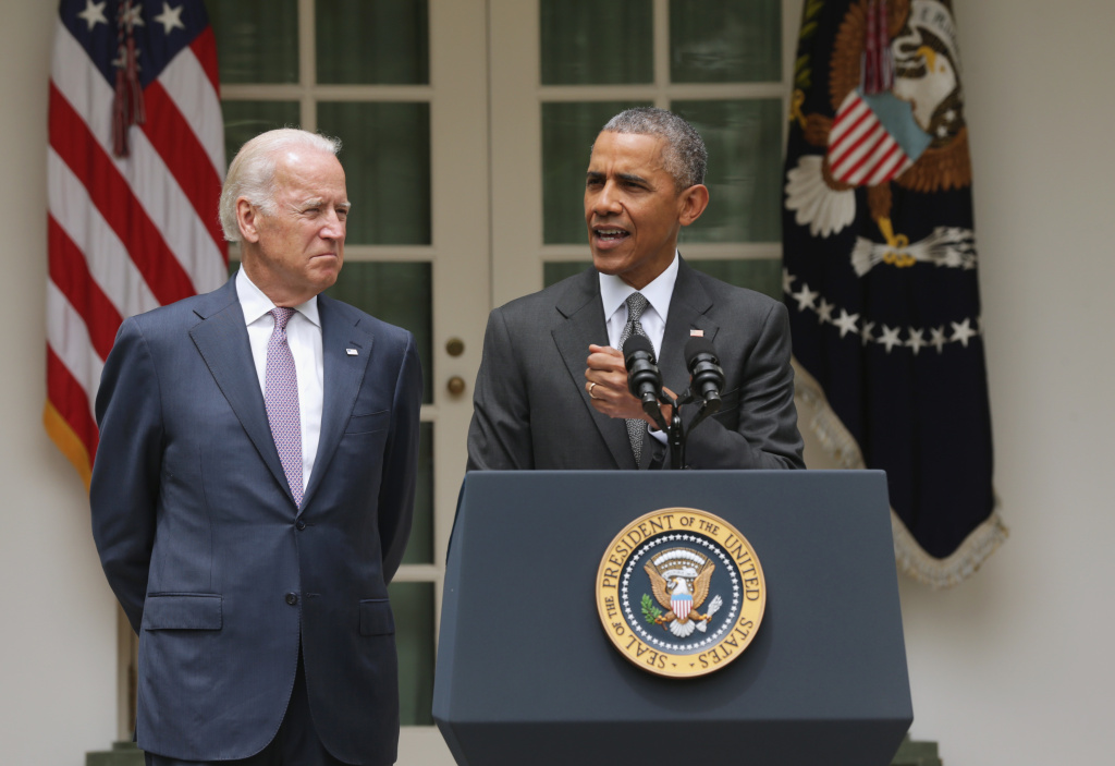 Former U.S. President Barack Obama, flanked by former Vice President Joe Biden, gives a statement in the Rose Garden at the White House in Washington, DC. in June, 2015.