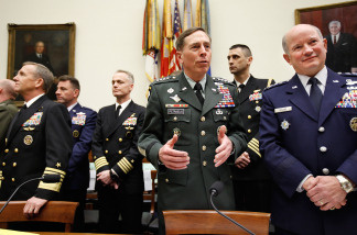 U.S. Army Gen. David Petraeus (C), commander of the U.S. Central Command; Navy Adm. Eric Olson (L), commander of the U.S. Special Operations Command; and Air Force Gen. Duncan McNabb (R), commander of the U.S. Transportation Command, prepare to testify during a hearing on the FY2011 National Defense Authorization Budget Requests before the House Armed Services Committee March 17, 2010 in Washington, DC.