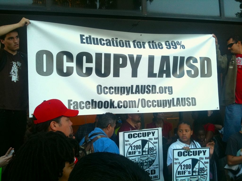 Protesters gather Tuesday afternoon in front of LAUSD headquarters under the banner of Occupy LAUSD. Join Patt Morrison with her monthly chat with LAUSD Superintendent John Deasy on the matter.
