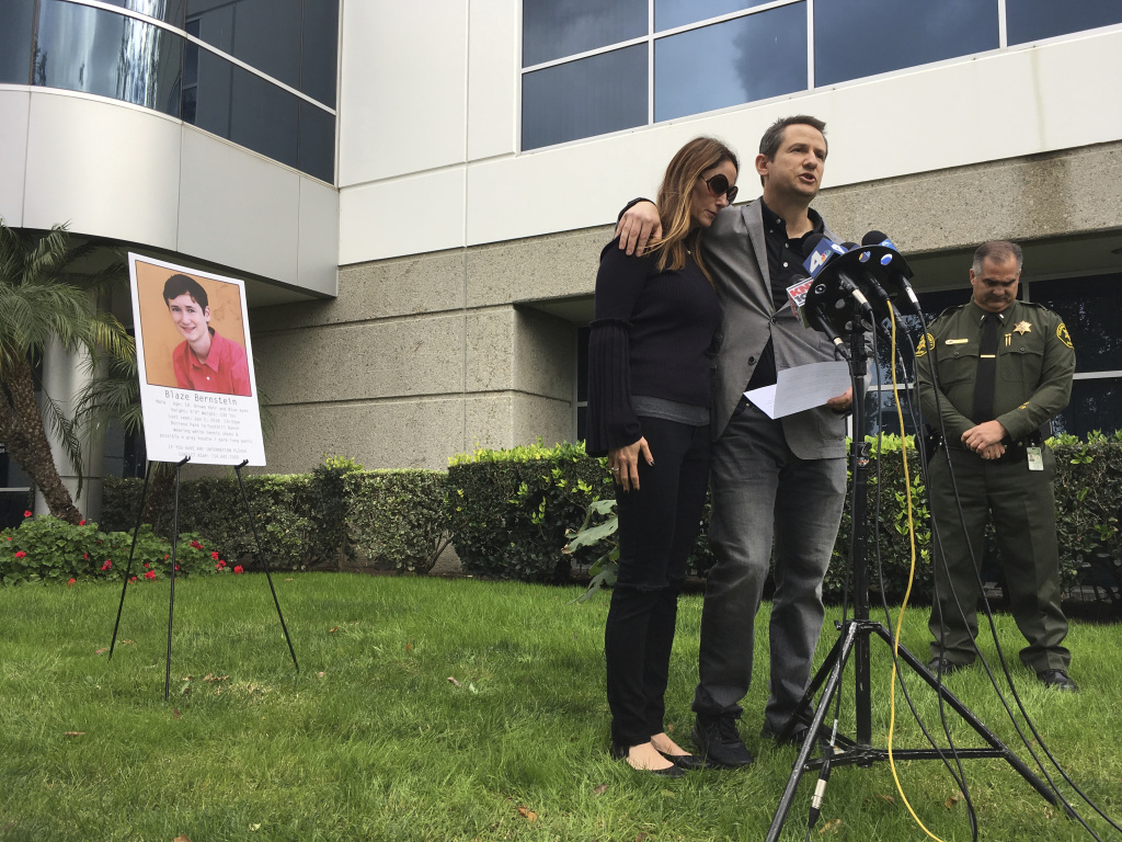 Jeanne and Gideon Bernstein, parents of murder victim Blaze Bernstein, 19, (pictured behind them) speak at a news conference in Lake Forest, Calif., on Jan. 10. Sam Woodward, 20, an alleged neo-Nazi and a former high school classmate of Blaze Bernstein, has been charged with stabbing him to death.