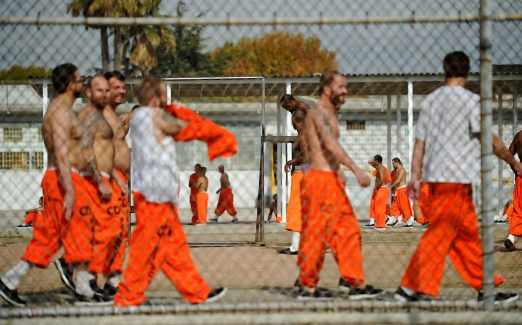 Inmates at Chino State Prison exercise in the yard December 10, 2010 in Chino, California. The U.S. Supreme Court is preparing to hear arguments to appeal a federal court's ruling last year that the California state prison system would have to release 40,000 prisoners to cope with overcrowding so severe that it violated their human rights. More than 144,000 inmates are currently incarcerated in prisons that were designed to hold about 80,000.