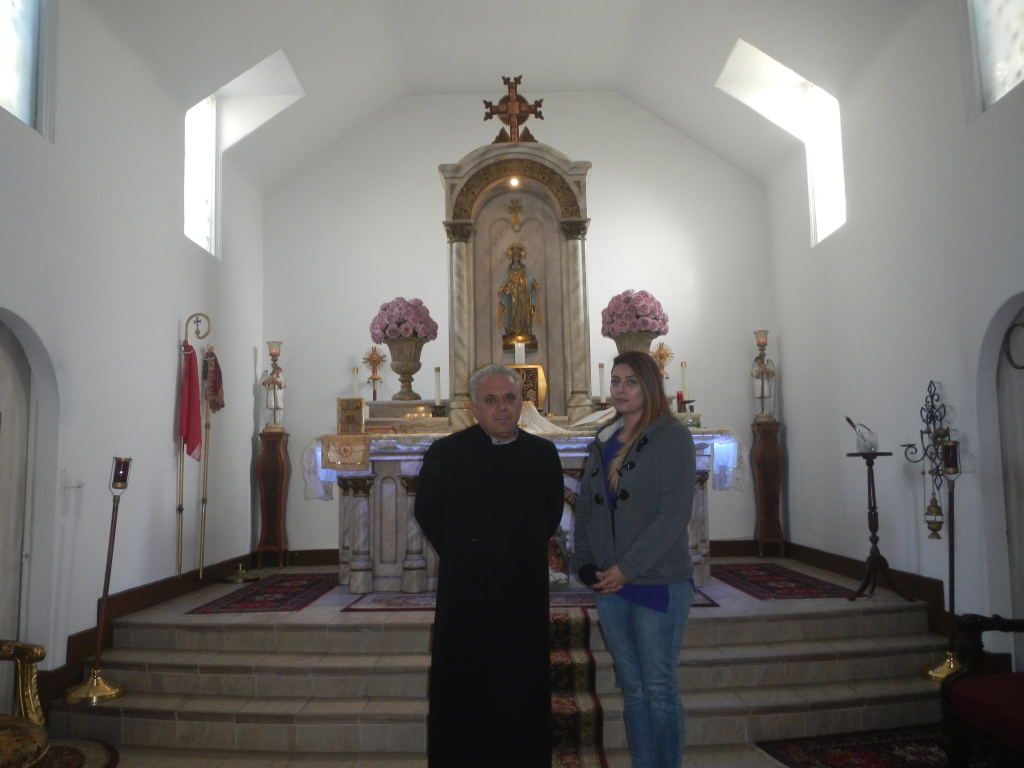 Father David Bedrossian withKaroun Baroussalian, a member of the congregation at Our Lady Queen of Martyrs Armenian Catholic Church in Los Angeles.