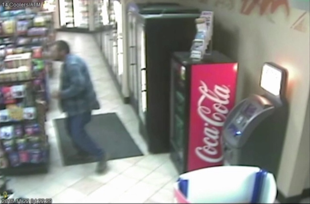A still from the video showing Fontana police officers confronting James Hill in a gas station convenience store before fatally shooting him.