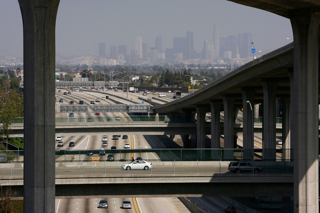 Traffic moves along the 110 freeway against a smoggy downtown skyline on March 14, 2008 in Los Angeles, California.
