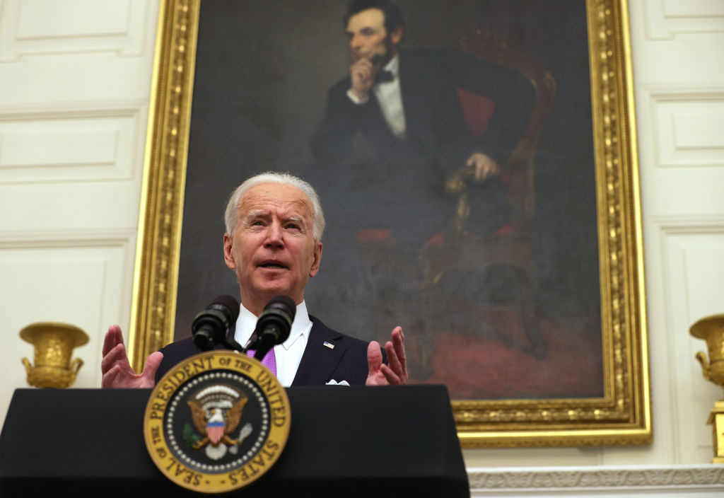 WASHINGTON, DC - JANUARY 21: U.S. President Joe Biden speaks during an event at the State Dining Room of the White House January 21, 2021 in Washington, DC.