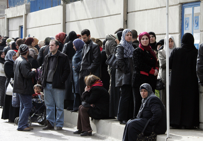 Iraqis wait outside the United Nations High Commissioner for Refugees (UNHCR) office in Duma, 15 kms north of Damascus, to register their names on February 13, 2008.