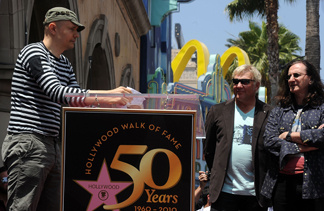 Musician Billy Corgan, left, speaks at the ceremony honoring Alex Lifeson and Geddy Lee of Rush who were honored with the 2,412th Star on the Hollywood Walk of Fame on June 25, 2010 in Hollywood, California. Hollywood celebrates the Walk of Fame's 50th Anniversary on July 25 with a day-long festival of open house tours.