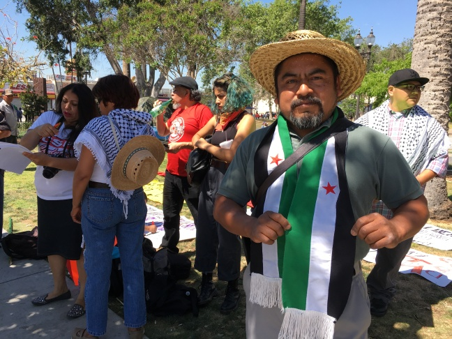 Arturo Blas, a mechanic from Pico Union, is here with Corriente Obrera, a workers group. He's here to honor May Day and protest President Trump and his policies.