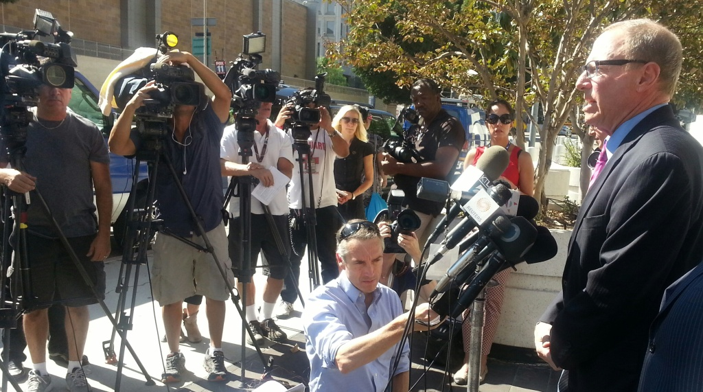 Attorney Steven Lerman talks to reporters outside the federal courthouse in downtown Los Angeles after filing a federal civil rights suit over the death of 25-year-old Ezell Ford.