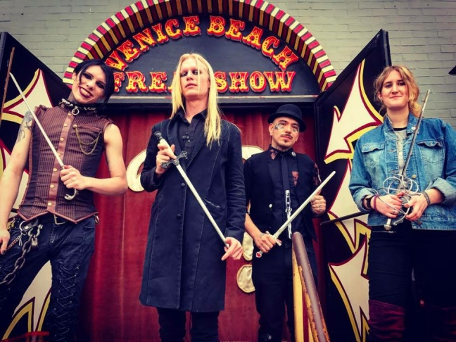 Famous sword-swallower Morgue (center) stands with other sword-swallowers in front of the Venice Beach Freakshow.