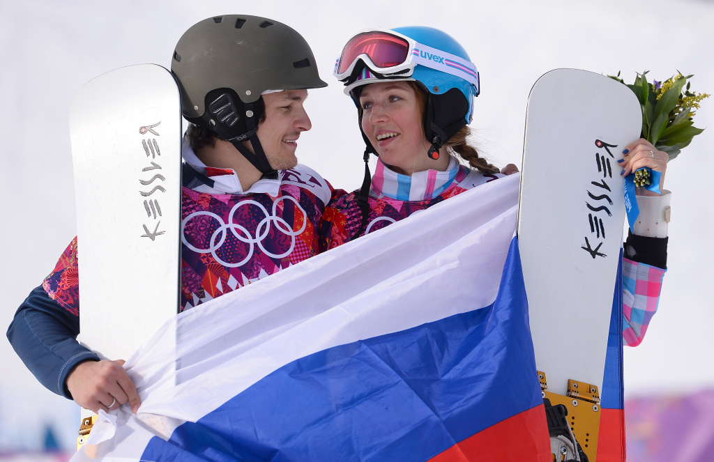 Men's gold medalist Vic Wild of Russia and women's bronze medalist Alena Zavarzina of Russia celebrate after the Snowboard Parallel Giant Slalom Finals on day twelve of the 2014 Winter Olympics at Rosa Khutor Extreme Park on February 19, 2014 in Sochi, Russia.