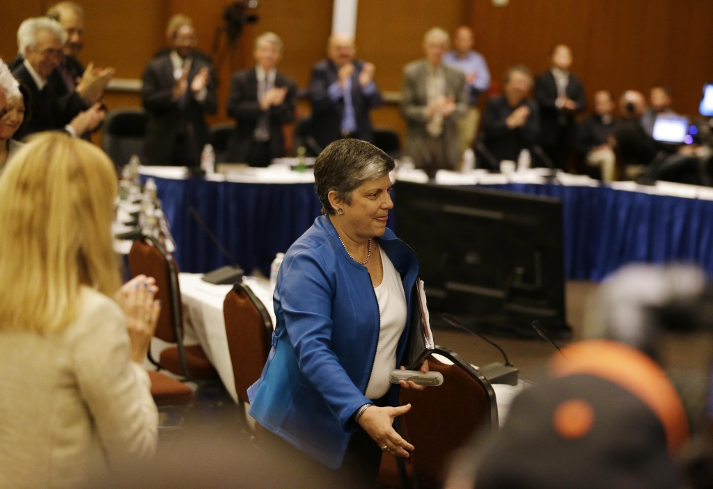 Homeland Security Secretary Janet Napolitano receives a standing ovation from the University of California Board of Regents after being elected as the next president at a meeting Thursday, July 18, 2013 in San Francisco. The University of California's governing board voted her to become the system's first female president, but her selection is being criticized by students upset about federal immigration policy and professors concerned about her lack of experience in academia. (AP Photo/Eric Risberg)
