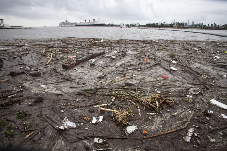 Trash collects along the shore after after a rainstorm in Long Beach, Calif. on Saturday, March 1, 2014. Evacuation orders remained in effect for hundreds of homes in Los Angeles County foothill communities where fires have burned away vegetation that holds soil in place, and bursts of rain caused the mountains to belch occasional debris flows.