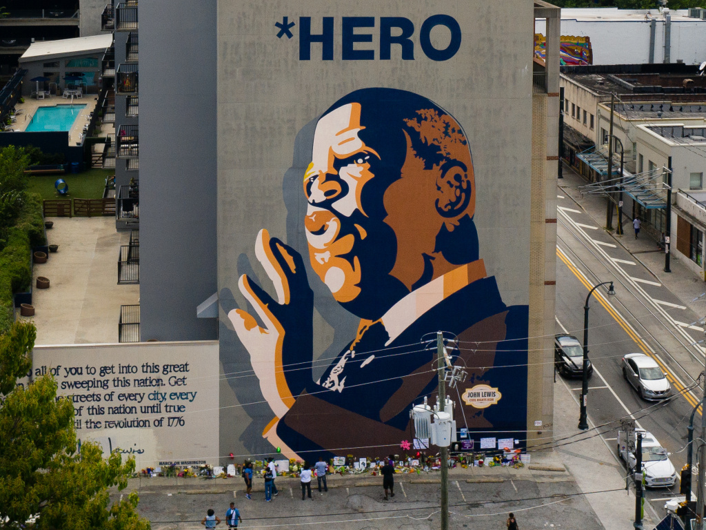 Mourners pay their respects at a mural of Rep. John Lewis painted on a building in Atlanta. The civil rights icon and congressman died on Friday.