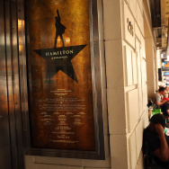 People, many who have been there for days, wait in line with dozens of others for tickets for the popular Broadway show Hamilton on June 21, 2016 in New York City.