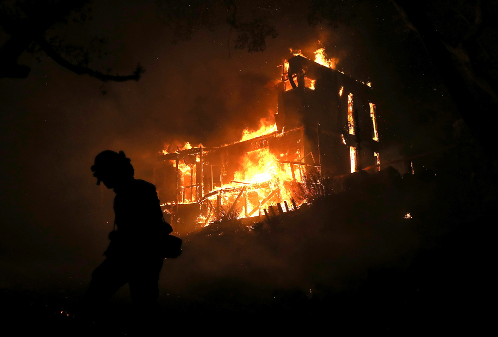 A home is consumed by fire during the Thomas fire on December 7, 2017 in Ojai, California. The Thomas fire has burned over 115,000 acres and has destroyed 439 structures.
