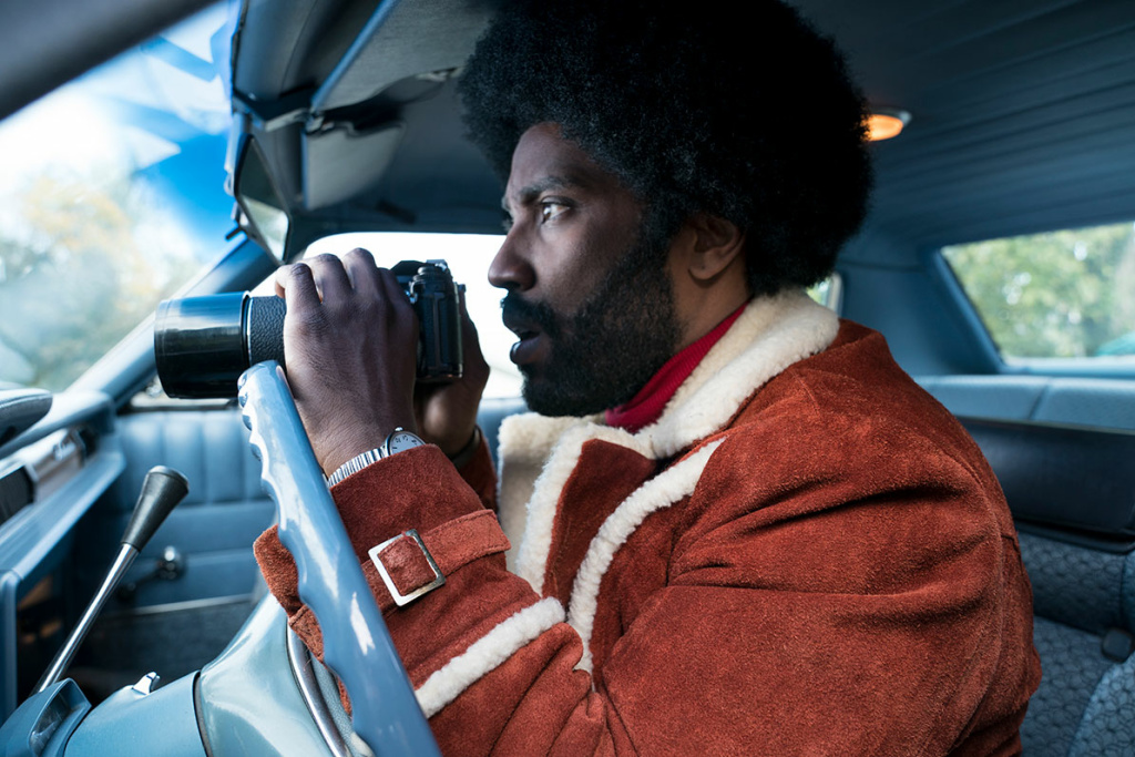 Detective Stallworth (Washington) surveys the situation in Focus Features' BlacKkKlansman