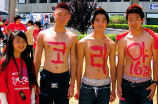 From left to right, Paula Shin, Raymond Yoo, Benny Kimm, Kevin Choi and Shawn Choi are red and ready to cheer on their team.