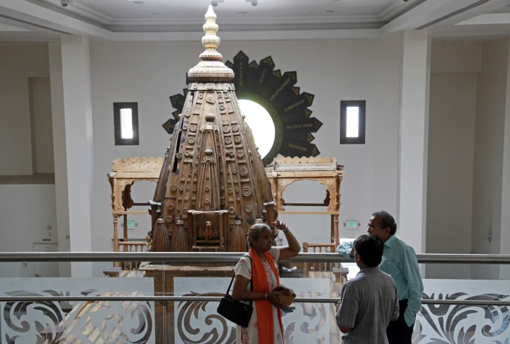 In this photo taken Friday, Aug. 16, 2013, the historic 1904 wooden Jain Temple structure, right, originally built for the 1904 St. Louis World's Fair, is seen reassembled and restored at the Jain Center of Southern California (JCSC) in Buena Park, Calif. The ancient Indian religion of Jainism, a close cousin of Buddhism, has a strict adherence to nonviolence that forbids eating meat, encourages days of fasting and places value on even the smallest of insects. In India, Jains account for about 1 percent of the population and the community in the U.S. counts about 150,000 followers.