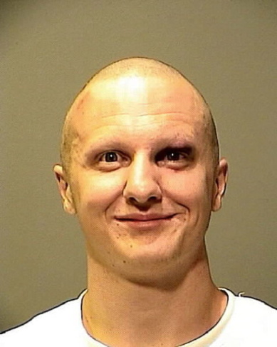 A copy photograph of the mug shot handed out by the FBI of the suspect Wade Michael Page after a press conference on the shooting at the Sikh Temple of Wisconsin a gunman fired upon people at a service August, 6, 2012 in Oak Creek, Wisconsin.
