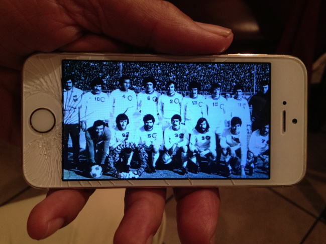 Hossein Rasoulinia, 65, displays a photo of himself (bottom row, second from left) posing with his soccer team in Iran 40 years ago.