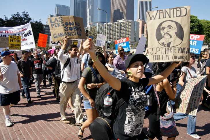 Participants in Occupy Los Angeles rally on the steps of City Hall after marching from Pershing Square.