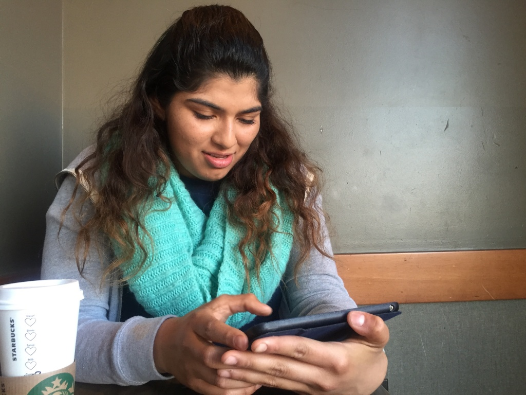 17-year-old Jennifer Cano edits her JobSnap profile in a coffee shop in Inglewood.