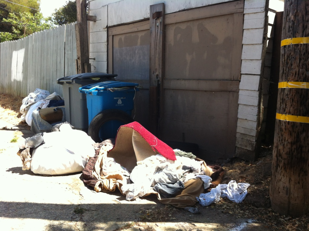 Garbage mounts up at foreclosed homes taken over by squatters in Vallejo.