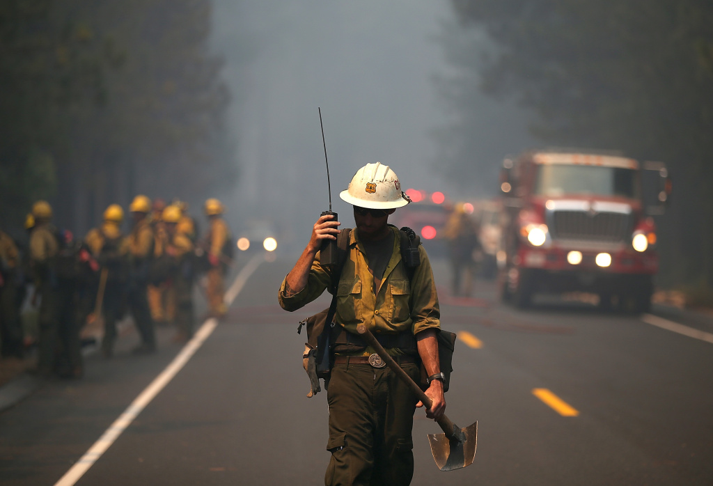 A U.S. Forest Service firefighter monitors a radio while battling the Rim Fire near Yosemite National Park.