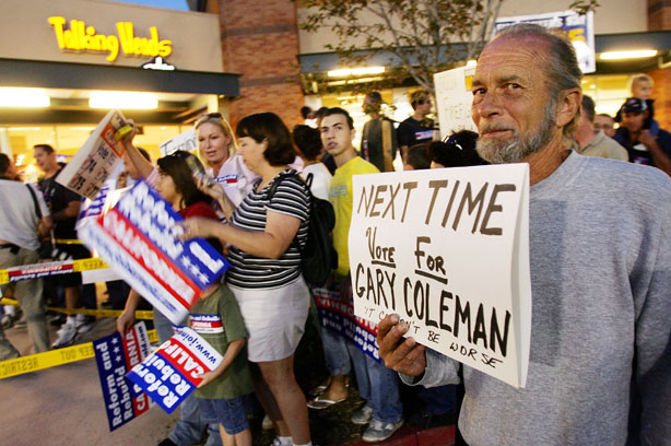 Art Cassel, who opposes California Governor Arnold Schwarzenegger's initiatives, displays a sign that says, 'next time vote for Gary Coleman,' during the governor's campaign stop at the Corona Republican Party Headquarters on the eve of his Special Election on November 7, 2005 in Corona, California. For nearly a century, voters in California have expressed their displeasure toward the government by means of the initiative and the recall. But some say that has only made it harder for elected officials to do their jobs and gain the voters' trust.