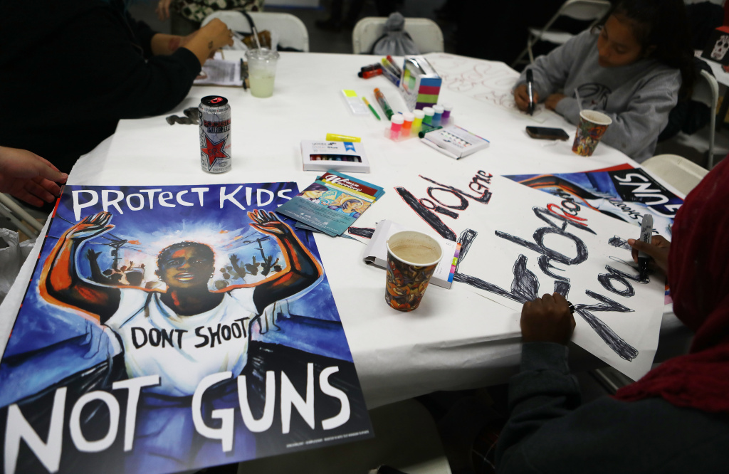 In this March 22 photo, young activists in Los Angeles paint signs to be carried at the upcoming March for Our Lives Los Angeles. More than 500,000 are expected to march for gun control at rallies nationwide on March 24.