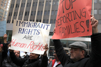 Immigrants, activists and supporters of illegal immigrants rally against a new Arizona law on April 27, 2010 outside of Federal Plaza in New York City.