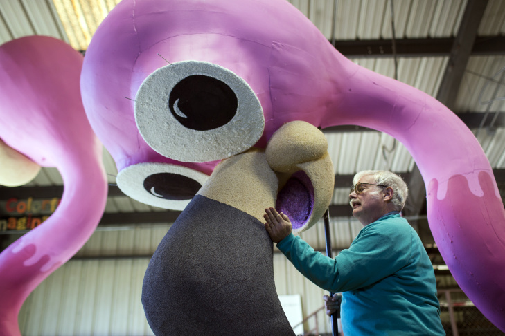 Volunteer David Gaydosh of Hawthorne patches poppyseed onto a bird beak at Sierra Madre Rose Float Association's barn on Tuesday morning, Dec. 29, 2015. The birds are part of a float for the 2016 Rose Parade on New Year's Day.