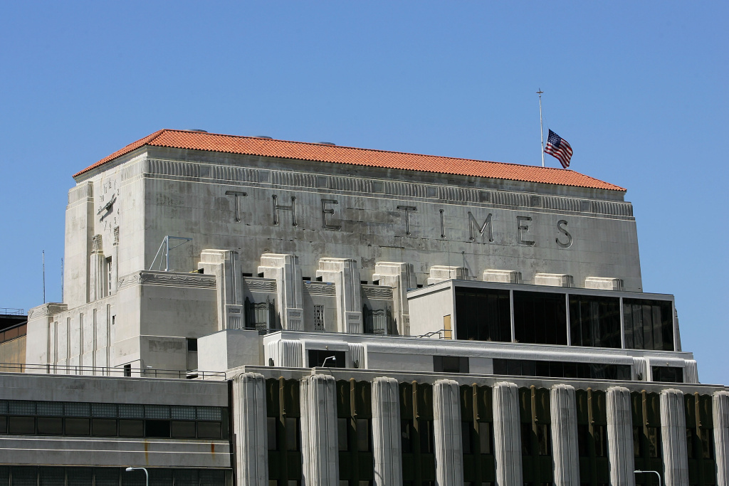 LOS ANGELES - APRIL 23:  A flag flies half-staff on top of the Los Angeles Times building April 23, 2007 in Los Angeles, California. The Times announced today that it will offer voluntary buyouts in an effort to cut its staff of 2,625 by up to 150. Up to about 70 of those jobs would be in the newsroom, dropping the news staff to about 850. When the Tribune Co. bought the newspaper in 2000, there were 1,200 employed on the news side. Last fall, publisher Jeffrey M. Johnson and then Editor Dean Baquet were forced from the paper for fighting against cuts in the newsroom and arguing that a reduction of reporters and editors would hurt the quality of the paper, a belief contrary to that of Tribune executives.  (Photo by David McNew/Getty Images)