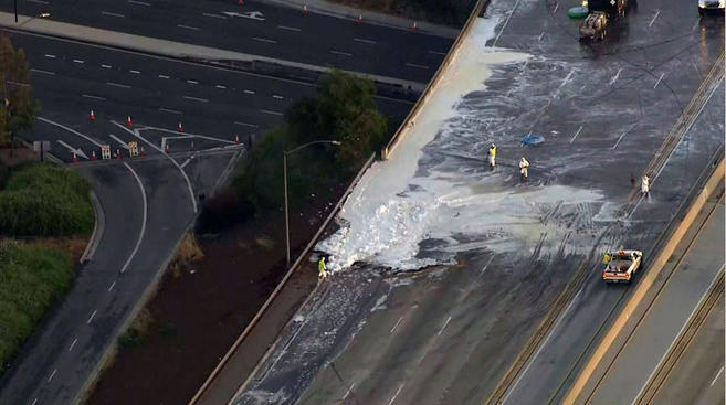 A stretch of the southbound 605 Freeway and a northbound lane in the Lakewood area was shut down overnight Wednesday, Apr. 8, 2015 after a tanker truck overturned.