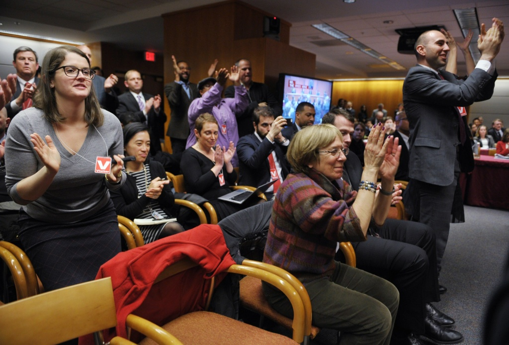 Attendees applaud after Federal Communications Commission Chairman Tom Wheeler announced the FCC ruling on net neutrality on February 26, 2015 in Washington, DC.
