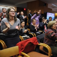 Attendees applaud after Federal Communications Commission Chairman Tom Wheeler announced the FCC ruling on net neutrality on February 26, 2015 in Washington, DC. The FCC apporved net neutrality rules by a vote of 3 to 2.