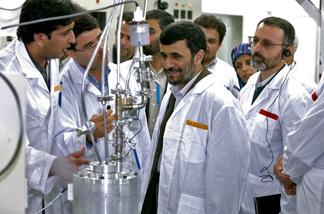Iranian President Mahmoud Ahmadinejad (C) visits the Natanz uranium enrichment facilities April 8, 2008 200 miles (322 km) south of the Tehran, Iran.