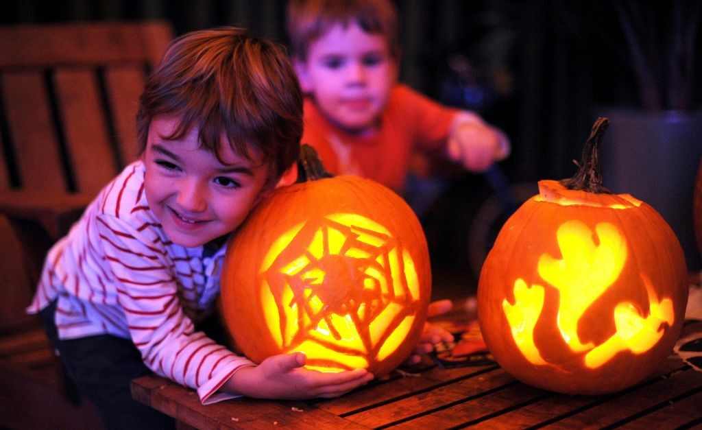 Pavle Matic, age 3, hugs the pumpkin carved by his father.