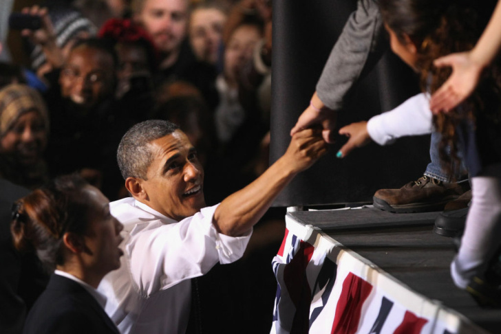U.S. President Barack Obama greets college students after speaking at the University of Colorado Denver campus in Denver, Colorado.