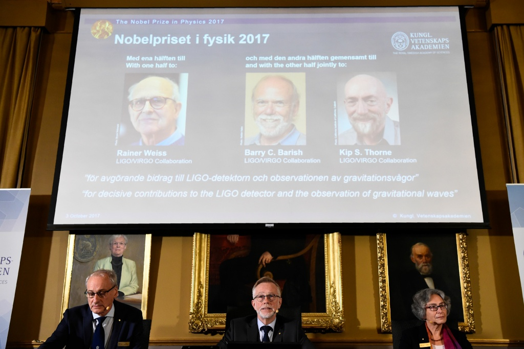 Nobel Committee for Physics members (Bottom L-R) Professor Nils Martensson, Goran K Hansson and Olga Botner announce the 2017 Nobel Prize winners in Physics on October 3, 2017, at the Royal Swedish Academy of Sciences in Stockholm. (On the display) 2017 laureates for the Nobel Prize in Physics are: Rainer Weiss, Barry C. Barish and Kip S. Thorne.  / AFP PHOTO / Jonathan NACKSTRAND        (Photo credit should read JONATHAN NACKSTRAND/AFP/Getty Images)