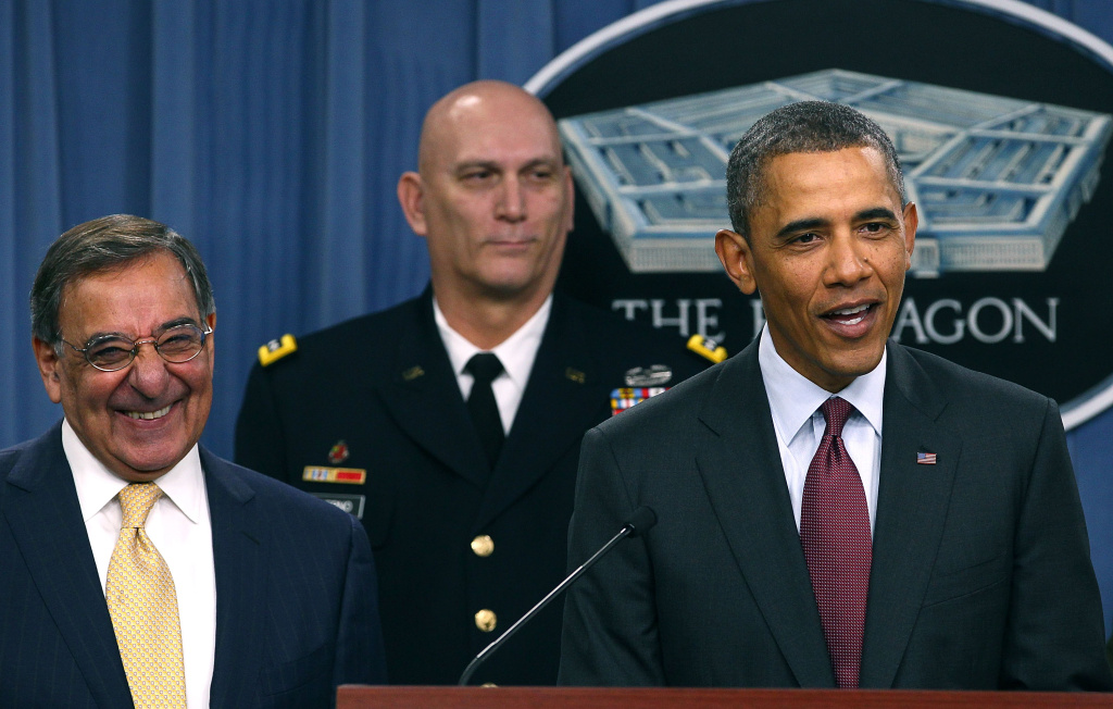 U.S. President Barack Obama (R) speaks while flanked by Secretary of Defense Leon Panetta (L), and Chief of Staff U.S. Army Gen. Raymond Odierno (C), at the Pentagon on January 5, 2012 in Washington, DC.