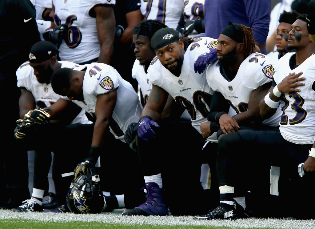 Baltimore Ravens players kneel for the American National anthem during the NFL International Series match against the Jacksonville Jaguars on September 24, 2017 in London, England.