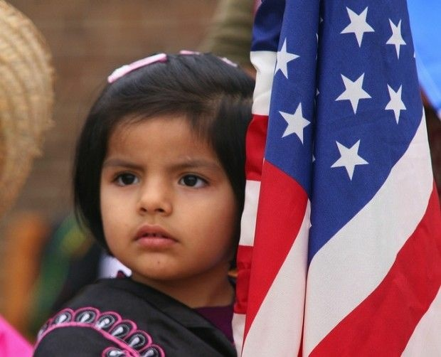 A child participates in a parade of flags, October 2010