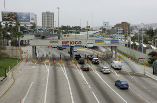 Motorists head into Mexico at the border in San Ysidro, California.